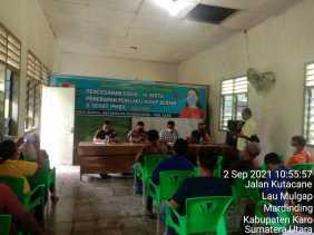 Babinsa Serma Muhamin Hadiri Sosialisasi Covid-19 di Desa Rimo Bunga