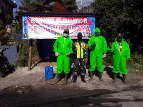 Babinsa Koramil 02/TP Tugas Jaga di Pos Relawan Covid di Desa Bunuraya: Minta Warga Pakai Masker