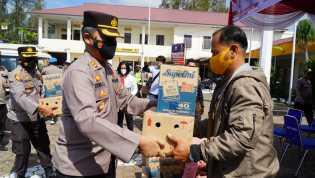 Sambut HUT Bhayangkara ke 75, Polres Tanah Karo Gelar Bhakti Sosial Bagikan Sembako